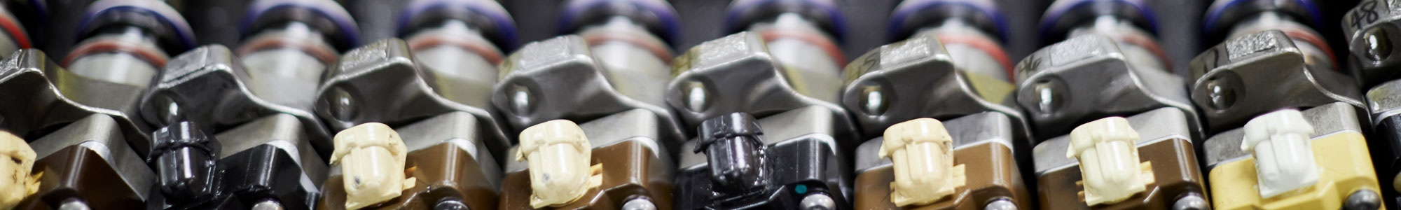 A row of remanufactured Delphi Technologies diesel injectors