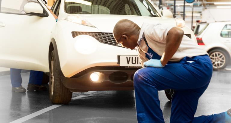 Technician diagnosing MoT failure