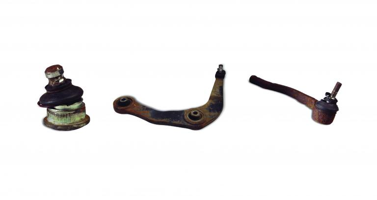Worn or damaged ball joint, control arm and outer tie rod