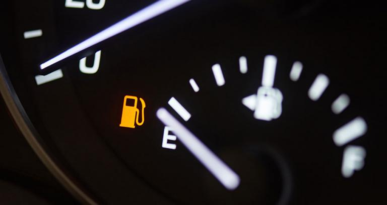 Image of a vehicle fuel gauge on empty